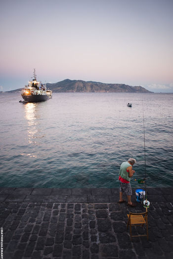 Fisherman of Salina 24mm Big Boat Boat Color End Of The Day Eolian Islands Fisher Fisherman Island Italie Lipari Minolta Lens People Sea Sicile Sicilia Streetphotographie Sunset