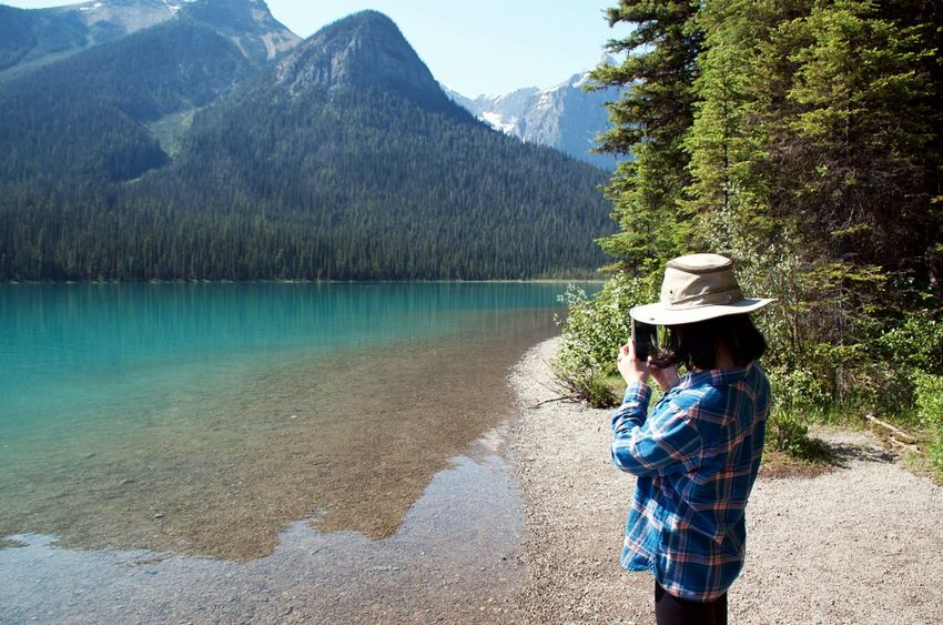 Canadian Rockies  Hiking Waters Edge Woman Taking A Picture With Smartphone Admiring Nature's Beauty Adventure Blue Water British Columbia Emerald Lake Glacial Lake IPhone Photography Lake Reflection Mountain Mountain Range Outdoors Peacfeul Reflection In Water Scenics - Nature Travel Destinations Woman At The Edge Of A Lake Woman Taking Pictures Of Nature My Best Travel Photo