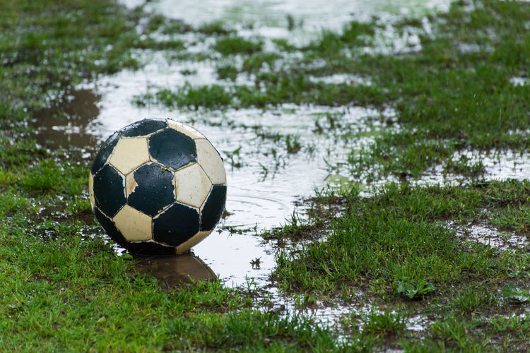 Soccer ball on field by lake