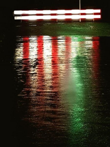 Reflection No People Water Illuminated Outdoors Night Stop Sign Stoplight Rainy Night Reflections In The Water Reflection
