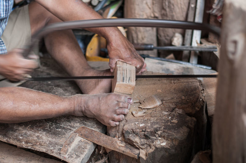 Man working on wood