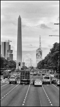 Traffic car, the Obelisk and the portrait of Evita Peron on July 9th Avenue, Buenos Aires, Argentina. Taking Photos Car EyeEm Architecture Urban Photography Urban Architecture Evita Peron Street Photography Sony Traffic Cars Streetphotography Eye4photography  Buenos Aires Argentina Argentina Photography Travel Travelphotography Buenosaires Obelisco, Buenos Aires 🌆 Obelisk Blackandwhite Photography B&w Black And White Collection  Black&white