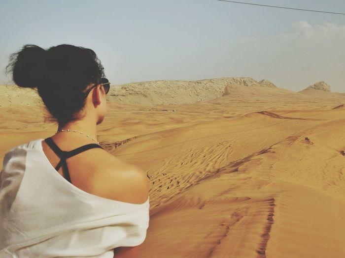 Rear view of man looking at desert