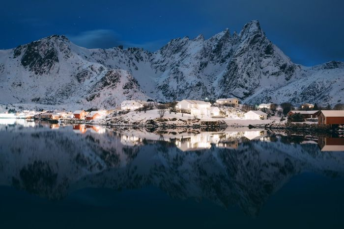 Clear Nights in lofoten Norway Lofoten Snow Mountain Water Beauty In Nature Scenics - Nature Cold Temperature Snowcapped Mountain Winter Sky Building Architecture Reflection Mountain Range House Nature Building Exterior Lake No People Lagoon