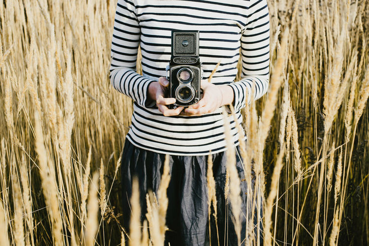 Camera Camera Cameras Close Up Close-up Day Film Film Photography Filmisnotdead Filmphotography Focus On Foreground Front View Grass Old School One Person Photo Photo Camera Photo-camera Photographing Photography Photography Themes Side View Standing Striped Vintage,