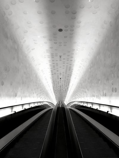 Low angle view of illuminated tunnel