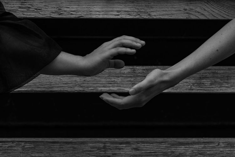 Body Language (Yin & Yang) ~ The Still Life Photographer - 2018 EyeEm Awards Body Part Day Finger Hand Human Body Part Human Hand Human Limb Leisure Activity Lifestyles Light And Shadow Monochrome Nature Outdoors People Real People Still Life Symbolism Table Togetherness Two People Water Women Wood - Material