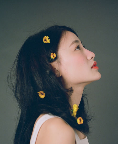 One Person Headshot Hairstyle Portrait Hair Young Women Lifestyles Young Adult Women Long Hair Looking Leisure Activity Indoors  Flower Real People Close-up Studio Shot Flowering Plant Black Hair Beautiful Woman Contemplation Profile View Human Hair Teenager