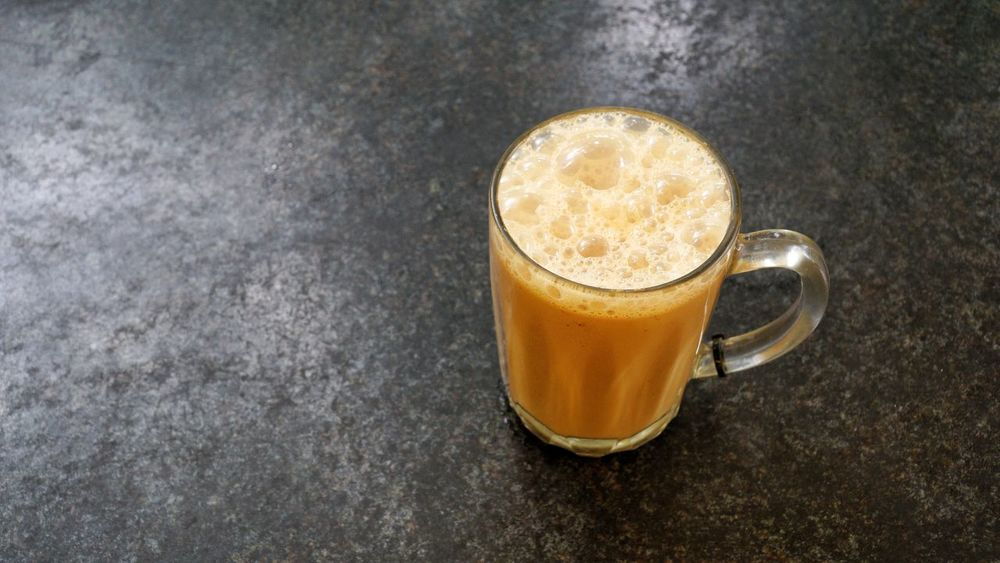 Teh tarik or pulled tea is a famous sweet milk tea in Malaysia. Drinks Tea Teh Tarik Close-up Coffee Cup Cup Drink Food Food And Drink Freshness Frothy Drink High Angle View Hot Drink Indoors  Latte Mug No People Pulled Tea Refreshment Single Object Still Life Table