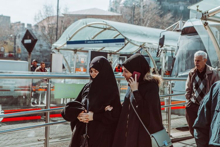 People standing in city during winter