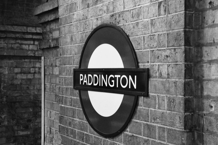 London Communication Sign Text Wall Brick Brick Wall Western Script Wall - Building Feature Architecture Built Structure Close-up No People Information Geometric Shape Circle Capital Letter Guidance Day Outdoors Building Exterior