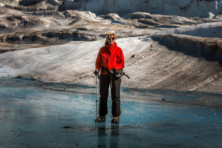 Woman Standing On Glacier