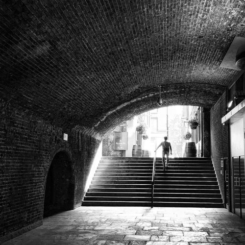 Wandering around London Steps Staircase Steps And Staircases Real People Arch Built Structure Indoors  Architecture One Person Full Length The Way Forward Walking Day Women Lifestyles Adult Adults Only People Walking Around The City  Walking Up Walking Up The Stairs Walking Towards The Sun EyeEm LOST IN London Postcode Postcards Be. Ready. Black And White Friday Black And White Friday Stories From The City Go Higher Adventures In The City #urbanana: The Urban Playground