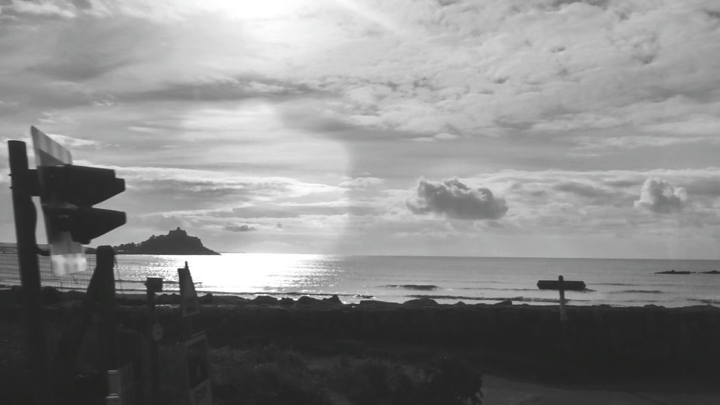 From the dirty window of a gwr train. Marizion looking at trafic lights with st michaels mount in the background. Streetphotography Street Photography Cornwall Coastal Lens Flare Moving Eye For Photography Beach Photography Eye4black&white  On The Train