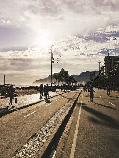 Ipanema Rio de Janeiro Brazil Rio De Janeiro Rio De Janeiro, Brazil Sunset Rio Sky Cloud - Sky Transportation Street Nature Sunlight City Road Street Light Water Built Structure Group Of People Real People Outdoors Incidental People Beach Sea Day Crowd Architecture The Street Photographer - 2019 EyeEm Awards