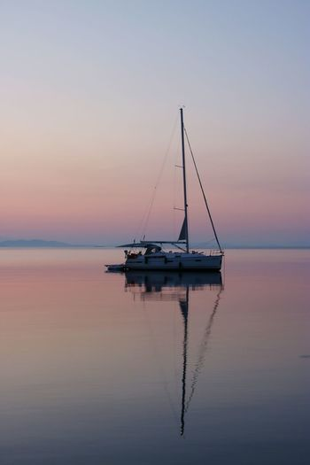 Sailor Sunrise_Collection Sunrise_sunsets_aroundworld Zut EyeEm Selects Croatia Water Nautical Vessel Sea Sunset Sailboat Blue Beach Reflection Sunlight HUAWEI Photo Award: After Dark 2018 In One Photograph