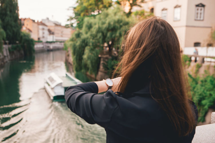 Close up portrait of Young woman city lifestyle with Watch on her wrist Water Long Hair Real People Hair Hairstyle Lifestyles Architecture Women One Person Built Structure Brown Hair Focus On Foreground Building Exterior Leisure Activity Rear View Nature Day River Outdoors Fashion Blogger Watch Urban Urbanphotography City Ljubljana Slovenia Portrait Portrait Of A Woman Woman Young Adult Young Women Casual Clothing Casual Look