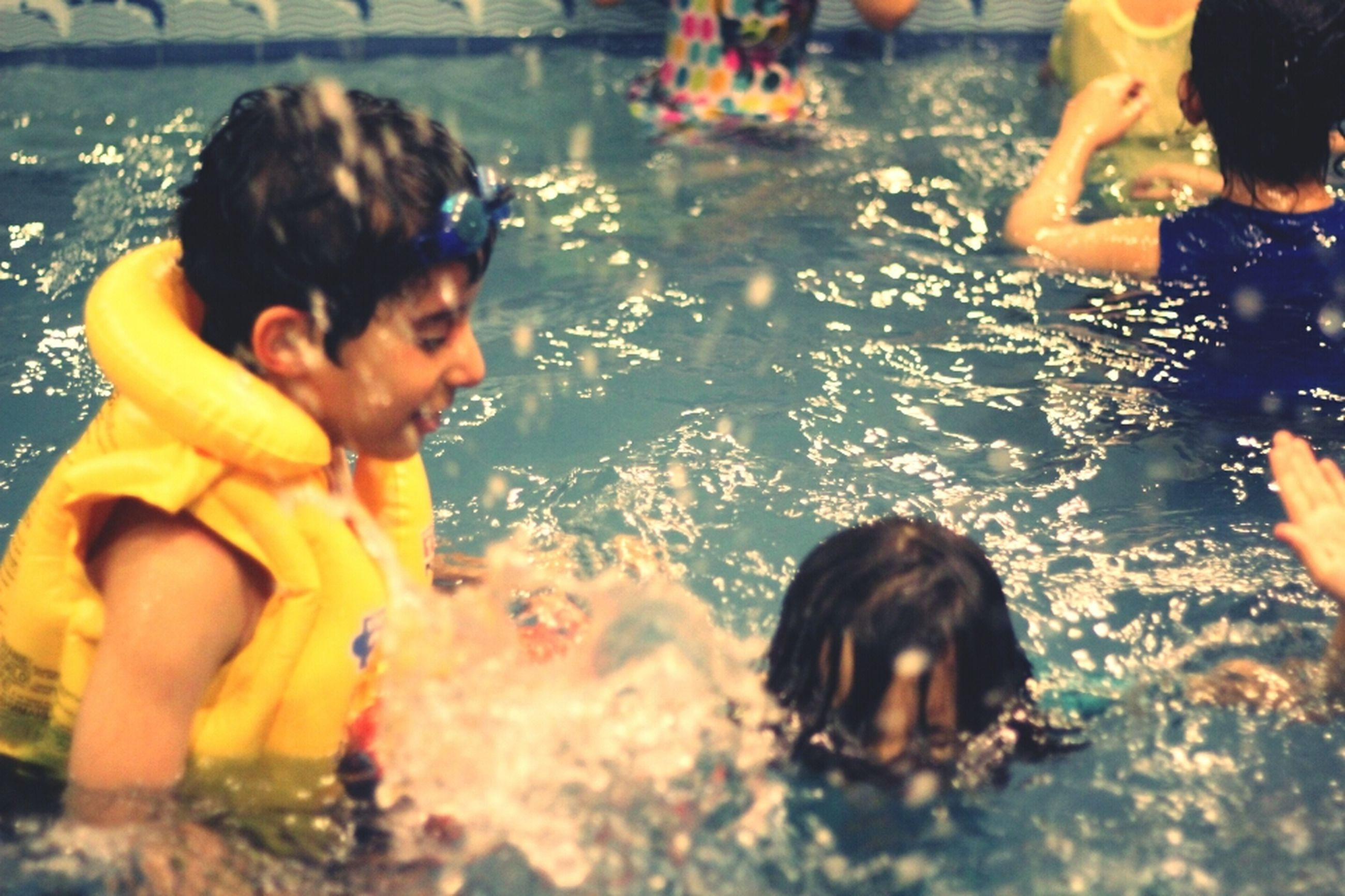 leisure activity, lifestyles, enjoyment, fun, childhood, togetherness, person, indoors, water, playing, girls, celebration, holding, boys, happiness, elementary age, large group of people
