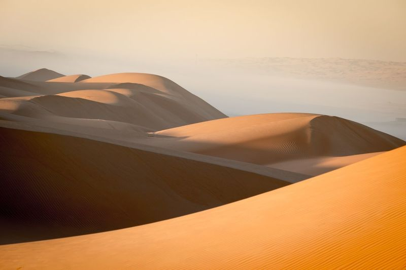 EyeEm Selects Sand Dune Desert Land Scenics - Nature Sand Beauty In Nature Geology Day Remote Nature Tranquil Scene Environment Tranquility Non-urban Scene Landscape Arid Climate No People Idyllic Sky Climate Sunlight Relaxation Beauty Outdoors Travel Nature Land Tranquility Desert