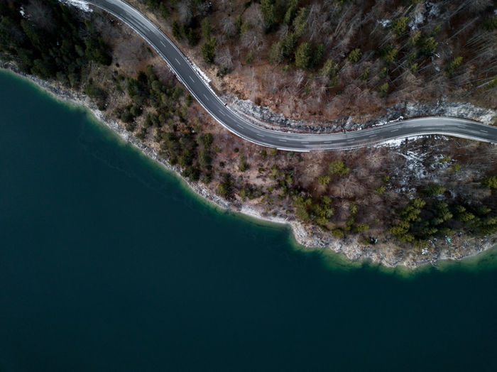 Aerial view of road by lake