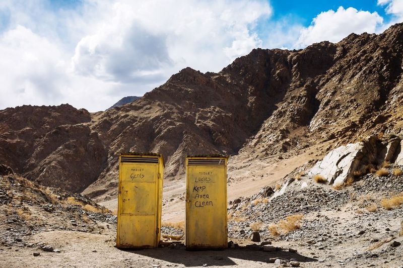 Portable Toilets On Mountain Against Sky