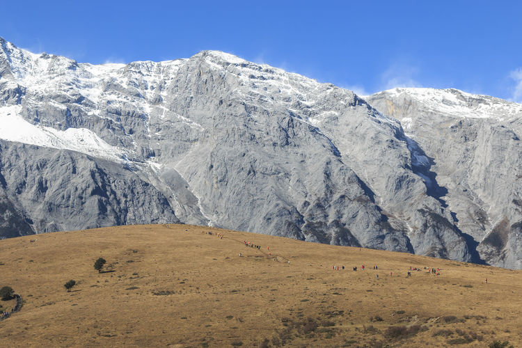 Scenic view of jade dragon snow mountain against sky