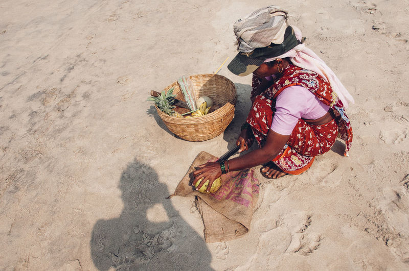 High angle view of woman working in basket