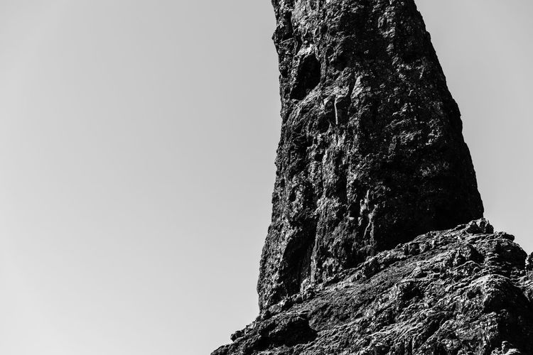 Rock Scotland Architecture Beauty In Nature Clear Sky Cliff Copy Space Day Formation Isle Of Skye Low Angle View Man Of Storr Mountain Nature No People Outdoors Plant Rock Rock - Object Rock Formation Rough Sky Solid Textured  Tranquility Tree The Great Outdoors - 2018 EyeEm Awards The Portraitist - 2018 EyeEm Awards