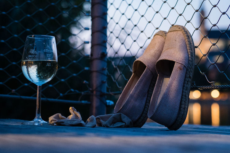 Quiet Moments Relaxing Blue Sky City Lights Closing The Day Enjoying Life Evening Fence Glass Of Wine Lake Peaceful Settling The Day Shoe Shoes Shoes Off Summer Summer Wine Wine Women's Shoes