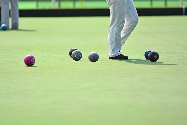 Lawn bowls on the green field People Athlete Man Woman Green Field Outdoor Lawn Bowls Bowl Bowling Healthy Sport Lawn Business EyeEm Selects EyeEm Best Shots EyeEmBestPics Eyeemphotography Backgrounds Golfer Golf Course Sportsman Golf Club Low Section Soccer Field Golf Green - Golf Course Competition Match - Sport Playing Field