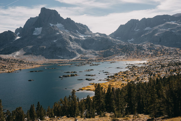 John Muir Trail Sierra Nevada Mountains Pacific Crest Trail California Hiking Thru Hiking Lake Lake View Lakeside Thousand Island Lake Mountain Scenics - Nature Beauty In Nature Tranquil Scene Tranquility Nature Mountain Range Landscape Cloud - Sky Water Environment Non-urban Scene No People Plant Sky Idyllic Tree Outdoors Mountain Peak Islands