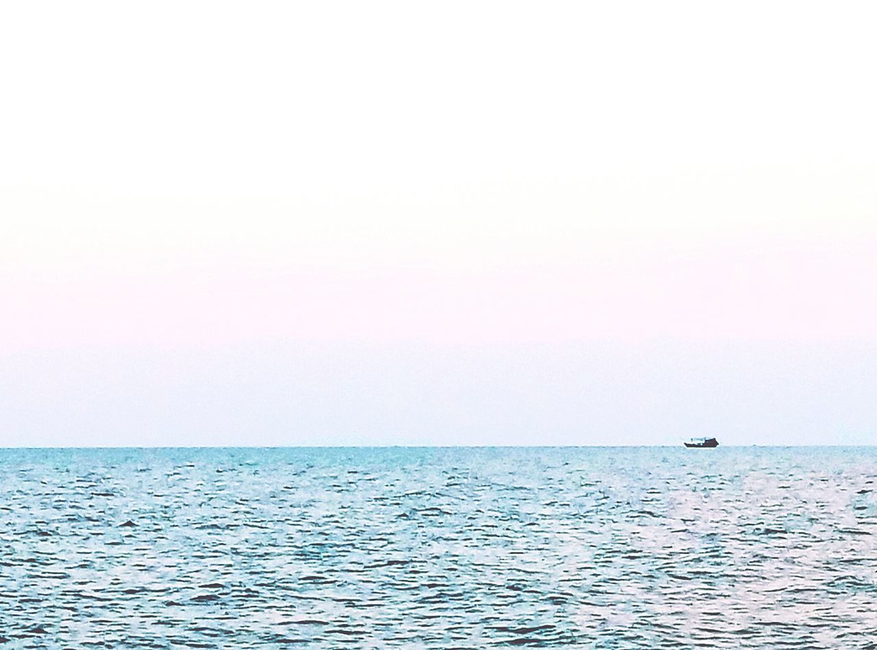 sea, horizon over water, water, scenics, beauty in nature, tranquility, nature, tranquil scene, copy space, waterfront, clear sky, outdoors, rippled, idyllic, sky, no people, day, nautical vessel