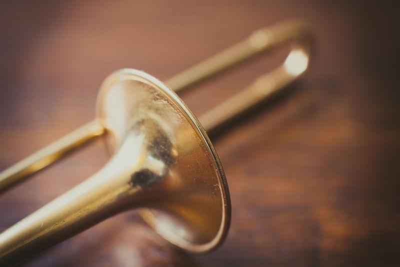 Close-up of trombone on floor