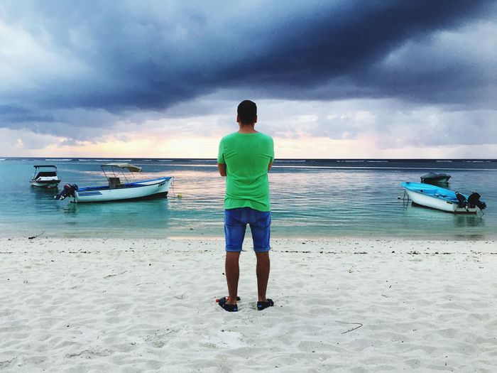 Man at the beach Mauritius Sunset Cloudy Sky Man At The Beach Sea Beach Cloud - Sky Sky Water Sand Nautical Vessel Nature