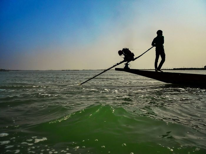 Silhouette Fishing Water Sea People Men Standing Nature Only Men Outdoors Sky Boat Puri Beach Odishatourism Fisherman Boat Chilika,Odisha Sublime Waves Seascape Engine Sterring