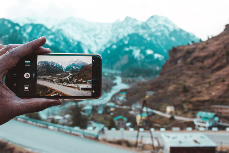Exploring Manali ... Human Hand Hand Mountain Photography Themes Holding Communication Human Body Part Real People Smart Phone Wireless Technology One Person Technology Focus On Foreground Activity Lifestyles Portable Information Device Photographing Leisure Activity Finger Human Finger Mountain Range Outdoors Manali Himalayas Himachalpradesh Snow Snowcapped Mountain Land Travel Exploring Wanderlust Tibet The Mobile Photographer - 2019 EyeEm Awards The Traveler - 2019 EyeEm Awards The Great Outdoors - 2019 EyeEm Awards
