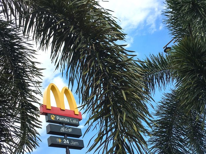 Mac Donalds Mac Donald Fast Food Franchising Franchise Low Angle View Sky Tree No People Outdoors Daylight Day Sign Signs Signage Signboard Logo Framing Framing The Subject Melaka Bandar Hilir Sky And Clouds