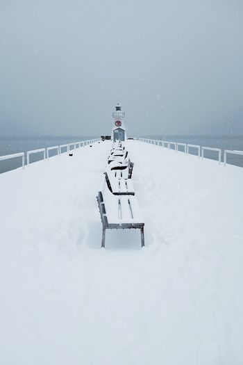 Port Dover in the snow. Canadian Winter Port Dover Christmastime Parkbench Priime Fuji X100t Fujifilm_xseries Lighthouse_lovers Lighthouse Snowfall Nature Outdoors Scenics Beauty In Nature Day Frozen Landscape Sky