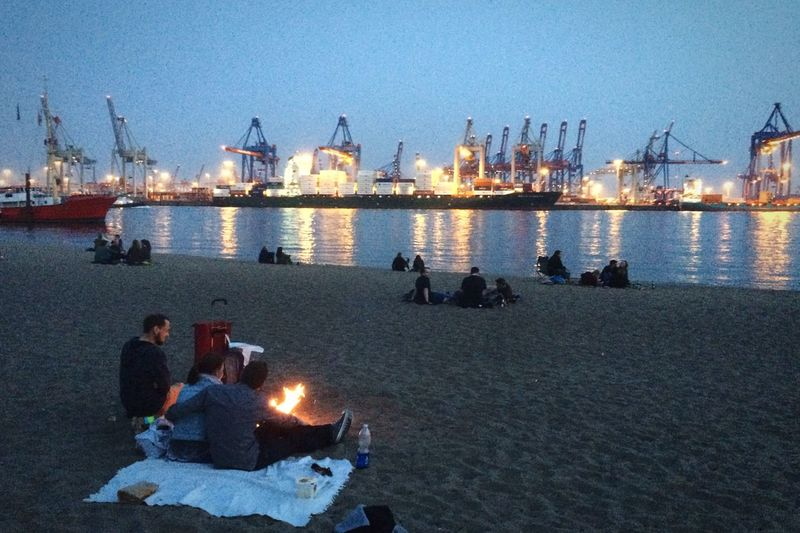 People Relaxing at the Beach Elbe Fire River Ship Open Edit Hidden Gems