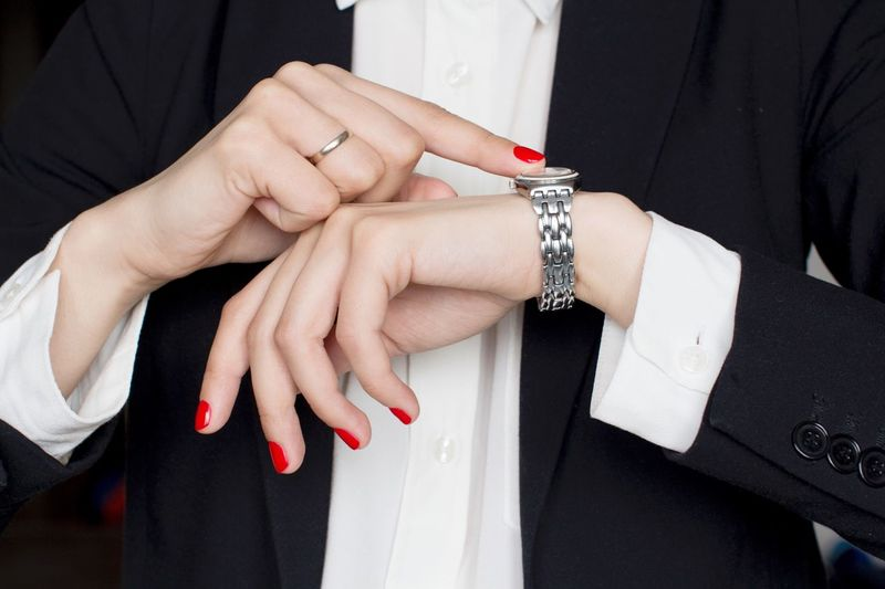 Young woman in black suit pointing wrist watch White Shirt Wristwatch Watch Time Menswear Suit Boss Stylish Working Hard Classical Style Blackandwhite Black And White Power Office Strongwoman Business Woman Human Hand Hand Jewelry Ring Women Adult Bracelet Nail Polish Bride Midsection Red Nail Polish Celebration Event Wedding