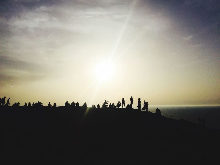 Sky Large Group Of People Real People Sun Nature Sunlight Sunset Lifestyles Beauty In Nature Sea Leisure Activity Women Outdoors Men Togetherness Scenics Horizon Over Water Water Day People Finding New Frontiers