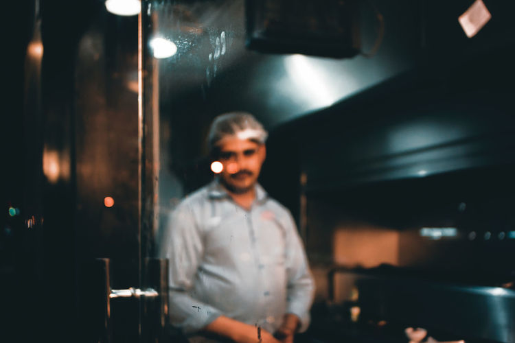unkown One Person Front View Restaurant Night Business Looking At Camera Nightlife Adult Standing Indoors  Real People Portrait Streetphotography Sony Voigtländer Nightphotography