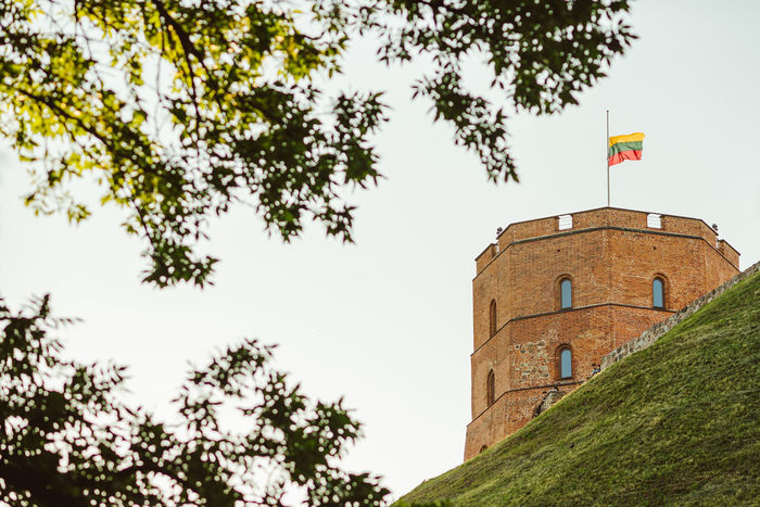 Vilnius Gediminas Castle Tower Architecture Building Exterior Built Structure Day Flag Gediminas Castle Gediminas Tower History Lietuva Low Angle View Nature No People Outdoors Sky Tower Travel Destinations Tree