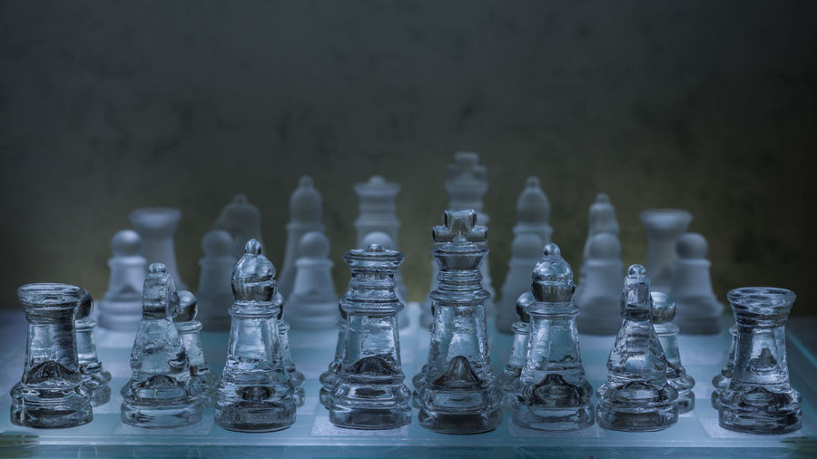 Nikon D7200 Large Group Of Objects Glass - Material Chess Board Game Game Indoors  Chess Piece Leisure Games Still Life King - Chess Piece Queen - Chess Piece Pawn - Chess Piece Knight - Chess Piece Relaxation In A Row Arrangement EyeEm Gallery EyeEm Selects Focus On Foreground Strategy Leisure Activity Chess Board Order