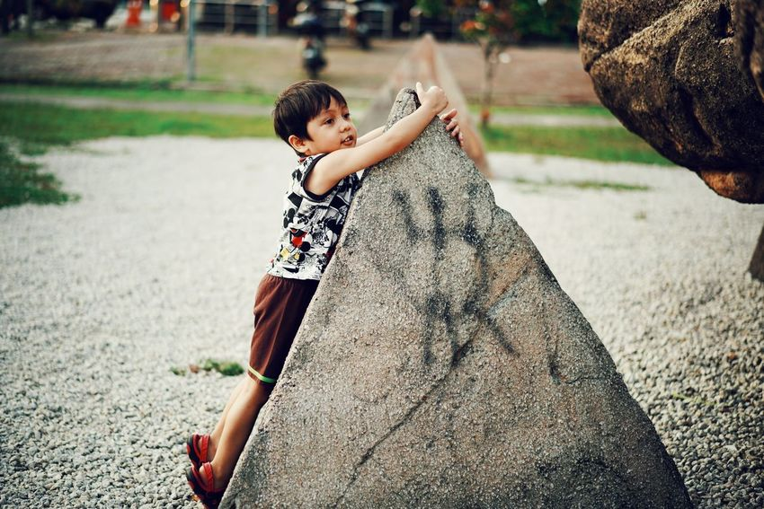 hugging stones EyeEmNewHere Kidsphotography Kids Being Kids Kids Childhood Child Full Length Playing Park - Man Made Space Fun Happiness Boys Playground Togetherness Outdoor Play Equipment