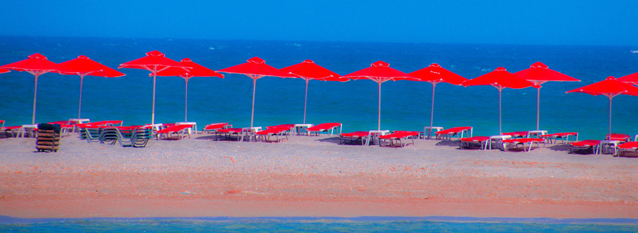 Colourful Beach umbrellas in Frangokastello Beach Umbrellas Frangokastello Crete Blue In A Row Multi Colored No People Sand Water