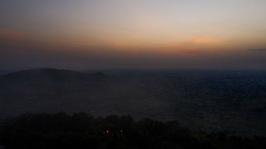 High angle view of city during sunset