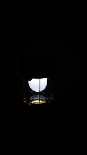 Close-up of illuminated lamp in darkroom