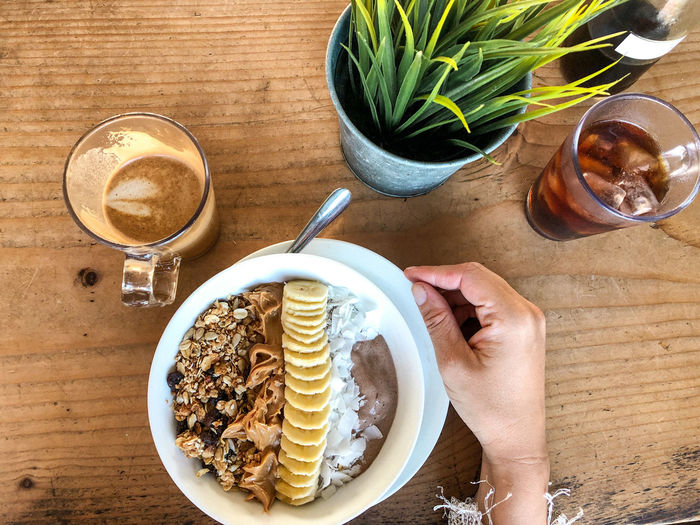Smoothie bowl Food And Drink Table Food Freshness Human Hand One Person Indoors  Human Body Part Hand Real People High Angle View Holding Lifestyles Finger Breakfast Smoothie Bowl Healthy Breakfast Vegan Food