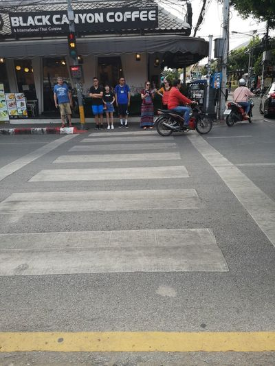 People crossing road in city